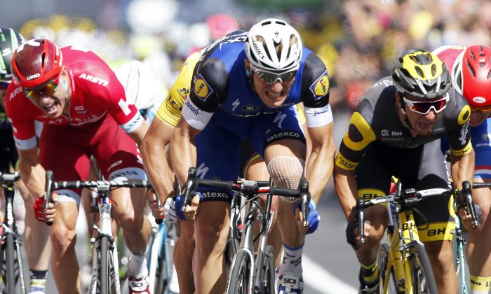 Etixx-Quickstep sprinter Marcel Kittel, center, leads Direct Energie's Brian Coquard, right, and Katusha's Alexander Kristoff (left) toward the finish line during Stage Four of the Tour de France, 237.5 kilometers (147.3 miles) from Saumur to Limoges, France, Tuesday, July 5, 2016. (AP Photo/Christophe Ena)