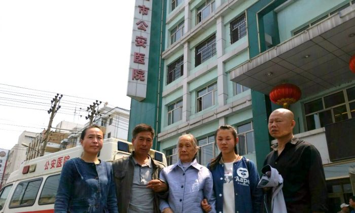 Gao Yixi's family stands outside the Mudanjiang Public Security Hospital on June 9, 2016. (Courtesy of family)
