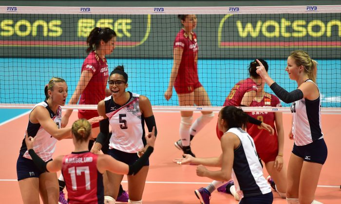 Team USA in buoyant mood during their win against China in their Pool H1 match in Hong Kong on Sunday June 26. The match tomorrow in Bangkok between the two teams will be will be another important challenge for both teams. (Bill Cox/Epoch Times)