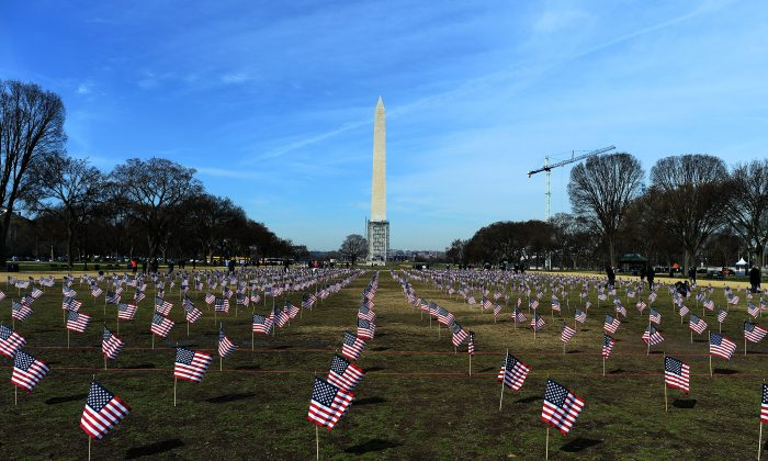 Some 1,892 American flags are installed on the National Mall in Washington, DC, on March 27, 2014. The Iraq and Afghanistan veterans installed the flags to represent the 1,892 veterans and service members who committed suicide this year. (Jewel Samad/AFP/Getty Images)