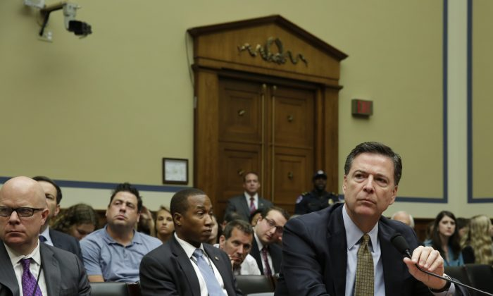FBI Director James Comey testifies before a House Oversight and Government Reform Committee hearing on Capitol Hill in Washington, DC, on July 7, 2016.  (YURI GRIPAS/AFP/Getty Images)