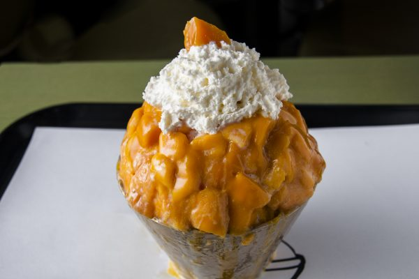 "Snowy Village's mango ""bingsoo"" (Korean shaved ice) features fluffy condensed-milk-infused ice and honey-sweet mangoes from Mexico. (Annie Wu/Epoch Times)"