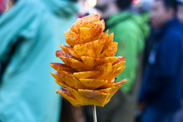 A mango flower sprinkled with chili and lime juice at the Richmond Night Market, a market featuring more than 100 food vendors, running through Oct. 10. (Annie Wu/Epoch Times)
