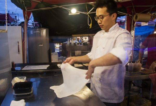 Eugene from the Mamak La vendor stall makes roti. (Annie Wu/Epoch Times)
