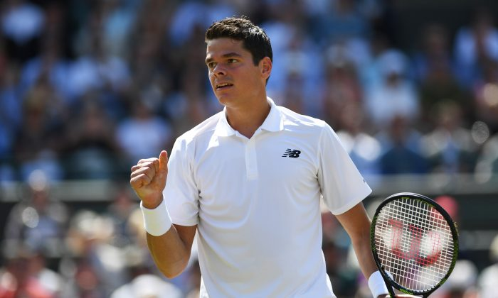 Milos Raonic of Canada celebrates victory during the Men's Singles quarter-final match of the 2016 Wimbledon Championships in London, on July 6. (Shaun Botterill/Getty Images)