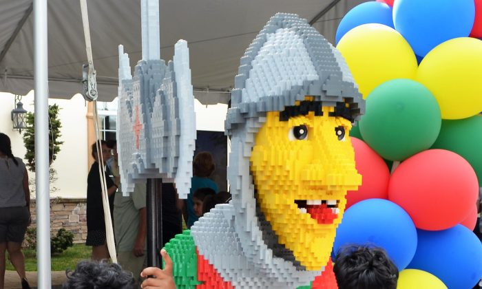 Christopher Harris and Randy Harris at the entrance of  the LEGOLAND New York open house in Goshen on July 7, 2016. (Yvonne Marcotte/Epoch Times)