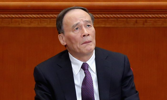 Secretary of the Central Commission for Discipline Inspection Wang Qishan attends the closing session of the Chinese People's Political Consultative Conference at the Great Hall of the People on Mar. 13, 2015 (Feng Li/Getty Images)