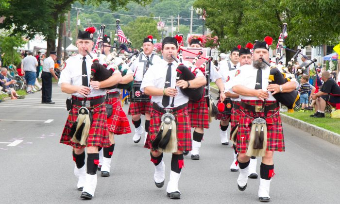 Newburgh Pipes and Drums playing in the 166th annual Port Jervis Fireman's Inspection Day Parade in Port Jervis on July 9, 2016. (Holly Kellum/Epoch Times)