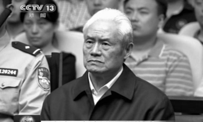 Zhou Yongkang in a courtroom in Tianjin where he was sentenced to life in prison on June 11, 2015.  (CCTV via AP)