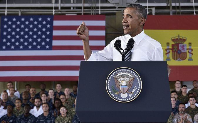 US President Barack Obama speaks to service members at the Naval Station Rota, in Rota, southwestern Spain on July 10, 2016. Obama said he will cut short a foreign trip and visit Dallas next week as the shooting rampage by the black army veteran, who said he wanted to kill white cops, triggered urgent calls to mend troubled race relations in the United States. / AFP / MANDEL NGAN (Photo credit should read MANDEL NGAN/AFP/Getty Images)