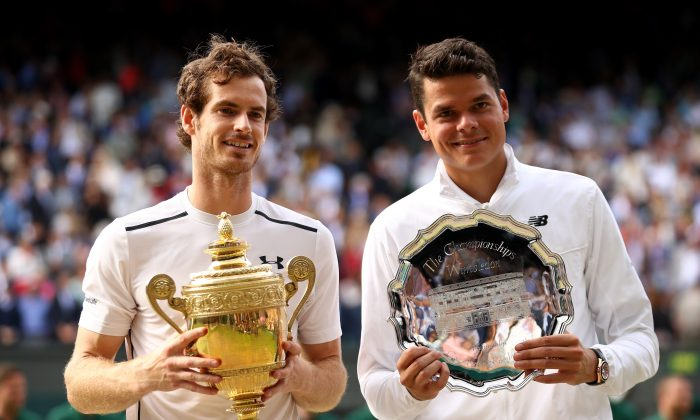Andy Murray and Milos Raonic hold their trophies after the men's final on July 10, 2016 in London, England. Murray won his second Wimbledon title against the Canadian playing in his first major final. (Julian Finney/Getty Images)