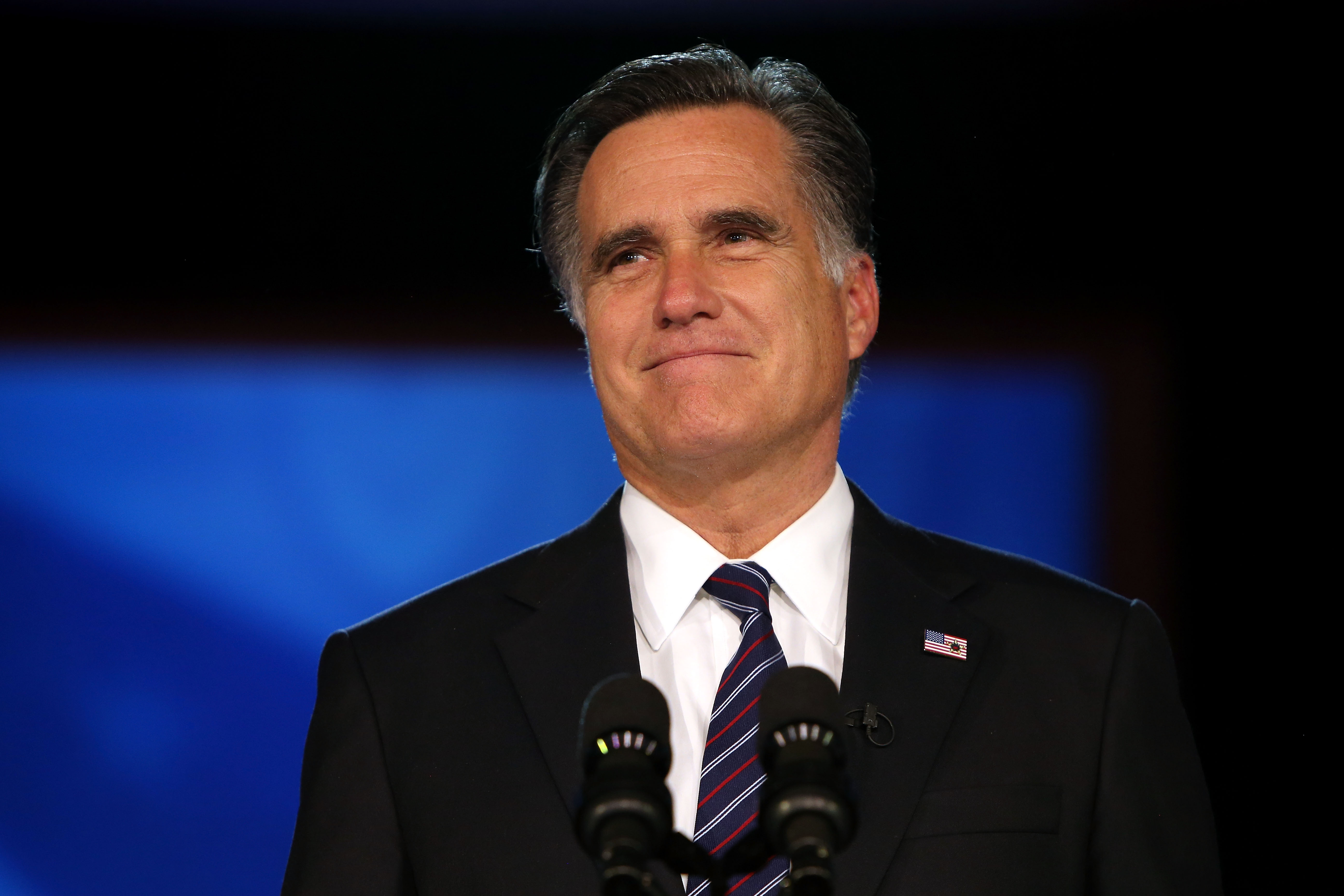 BOSTON, MA - NOVEMBER 07: Republican presidential candidate, Mitt Romney, speaks at the podium as he concedes the presidency during Mitt Romney's campaign election night event at the Boston Convention & Exhibition Center on November 7, 2012 in Boston, Massachusetts. After voters went to the polls in the heavily contested presidential race, networks projected incumbent U.S. President Barack Obama has won re-election against Republican candidate, former Massachusetts Gov. Mitt Romney. (Photo by Justin Sullivan/Getty Images)