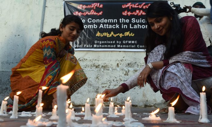 Pakistani residents light candles after a Taliban suicide bomber targeting Christians killed 72 people including many children on March 27, 2016. (ASIF HASSAN/AFP/Getty Images)