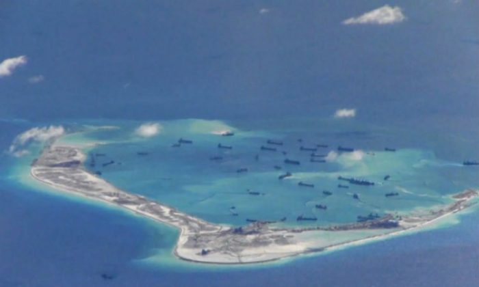 Chinese dredgers work on the construction of artificial islands on and around Michief Reef in the Spratly Islands of the South China Sea on May 2. The U.S. Navy recently sent a warship to patrol near the Chinese regime's man-made islands. (U.S. Navy)