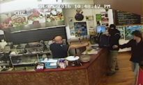 Video: Store Owner Ignores Armed Robber, Serves His Customer Instead