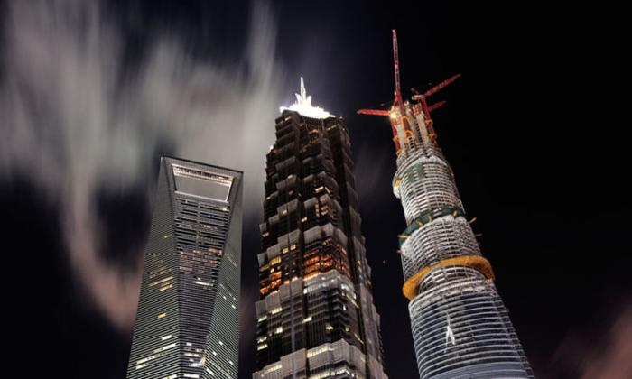 (L-R)Shanghai World Financial Center, Jin Mao Tower and Shanghai Tower. (via ChinaNews)