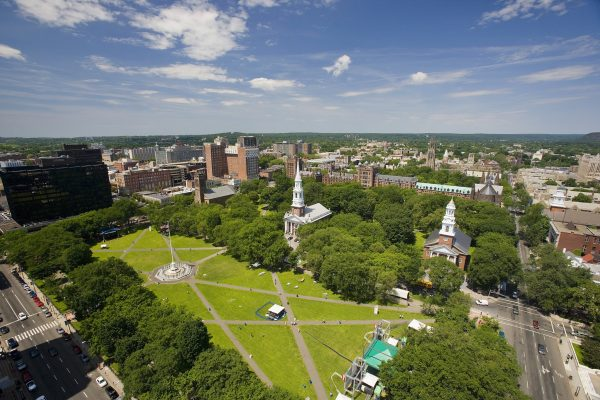 An aerial view of the New Haven Green, a park in downtown New Haven. It hosts outdoor festivals during the summer. (Courtesy of Market New Haven)