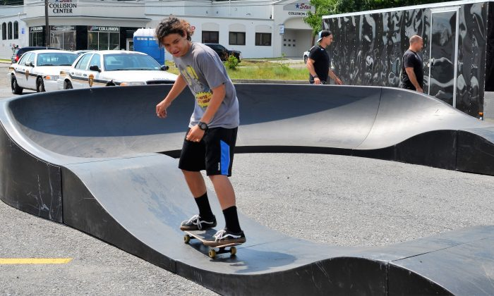 Kevin Rios, 15, tests the pumptrack on his skateboard in Middletown on July 13, 2016. (Yvonne Marcotte/Epoch Times)