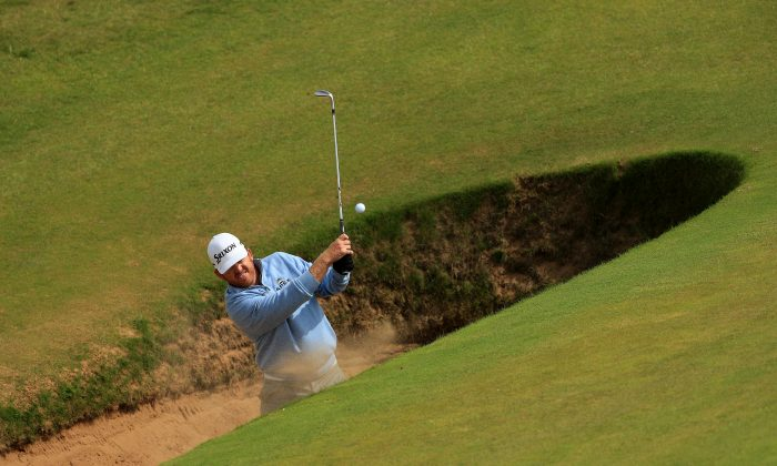 JB Holmes of the United States hits a bunker shot on the 8th during a practice round ahead of the 145th Open Championship at Royal Troon on July 12 in Troon, Scotland. (Mike Ehrmann/Getty Images)