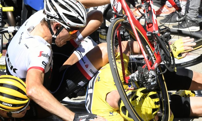 Richie Porte, Chris Froome, and Bauke Mollema fight their way through the crowd in the final kilometer of Stage 12 of the 2016 Tour de France, seconds before the trio crashed headlong into a TV motorcycle. (AP Photo/Peter Dejong)  Sky's Chris Froome, wearing the overall leader's yellow jersey, right, Trek-Segafredo's Bauke Mollema, center, and BMC's Richie Porte crash at the end of Stage 12 of the Tour de France, Thursday, July 14, 2016.  (Bernard Papon/ Pool Photo via AP)