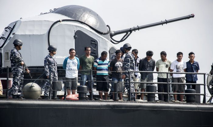 Indonesian navy soldiers display nine piracy suspects in Surabaya, East Java province, on May 10, 2016. (Juni Kriswanto/AFP/Getty Images)
