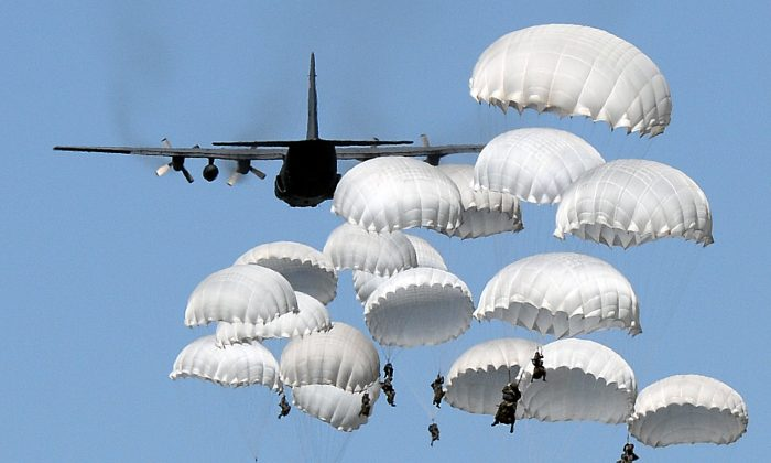 Polish troops land with parachutes at the military compound near Torun, Poland, on June 7, 2016, as part of the NATO Anaconda-16 military exercise.  (Janek Skarzynski/AFP/Getty Images)