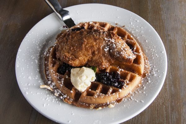 The Chicken and Waffles dish at Elm City Social is elevated with whipped whiskey butter and blackberry jam. (Annie Wu/Epoch Times)