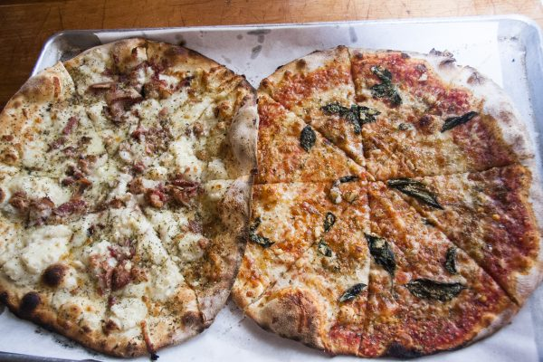Mashed potato and bacon pie (L) and mozzarella, tomato, and basil pie at Bar, a new-school pizza joint and bar. (Annie Wu/Epoch Times)