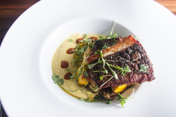 Pan-Seared Striped Bass with a creamy, spicy corn-oregano purée at farm-to-table restaurant Heirloom. (Annie Wu/Epoch Times)