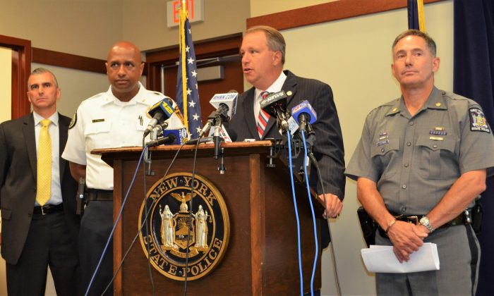 (L-R) Lt. John Ewanciw, Chief Ramon Bethencourt, District Attorney David Hoovler, and Major Joseph Tripolo at press conference at Troop F State Police headquarters in Middletown on July 13, 2015. (Yvonne Marcotte/Epoch Times)