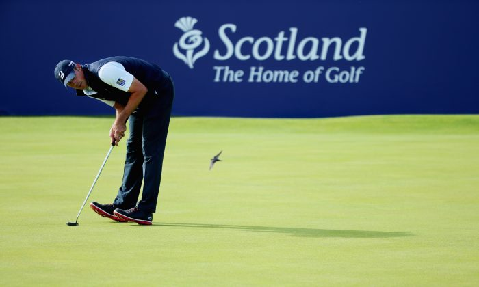 Matt Kuchar reacts to his putt on the 18th green during the second round of the Aberdeen Asset Management Scottish Open at Gullane Golf Club on July 10, 2015 in Gullane, East Lothian, Scotland. (Andrew Redington/Getty Images)
