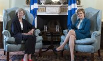 British PM May Removes Another Cameron Supporter as Minister