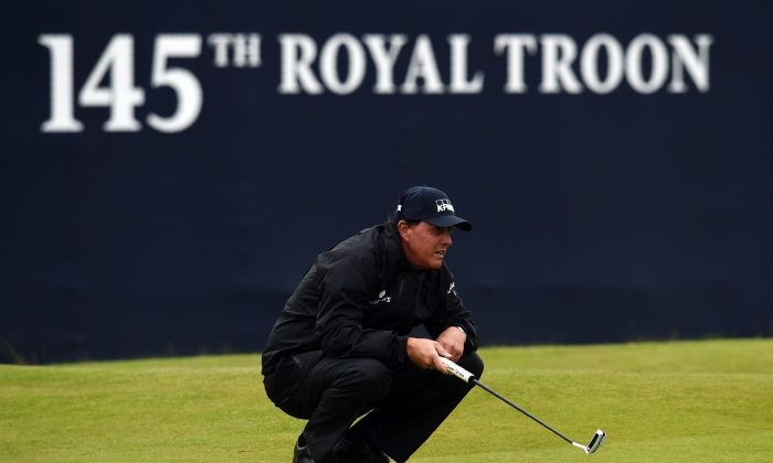 Phil Mickelson lines up a putt on the 18th green during his second round 69 on day two of the 2016 British Open Golf Championship at Royal Troon in Scotland on July 15. (Andy Buchanan/AFP/Getty Images)