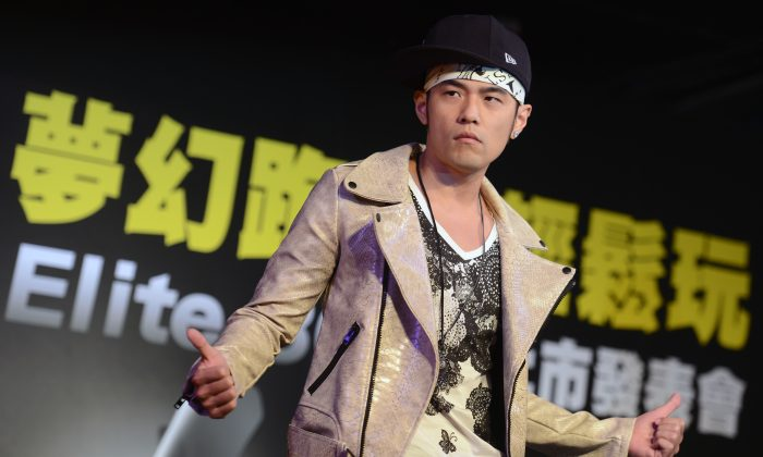 Taiwanese pop singer Jay Chou during a press conference to promote a local motorcycle in Taipei on March 29, 2013. A Chinese court stepped out of their way to insult the singer garnering strong criticism from the web. (SAM YEH/AFP/Getty Images)