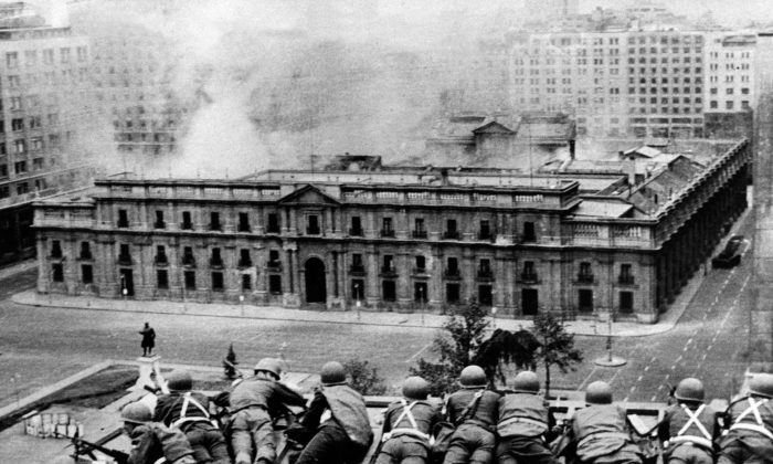Chilean Army troops positioned on a rooftop fire on the La Moneda Palace in Santiago on Sept. 11, 1973, during the military coup led by General Augusto Pinochet which overthrew Chilean president Salvador Allende, who died in the attack on the palace. (OFF/AFP/Getty Images)