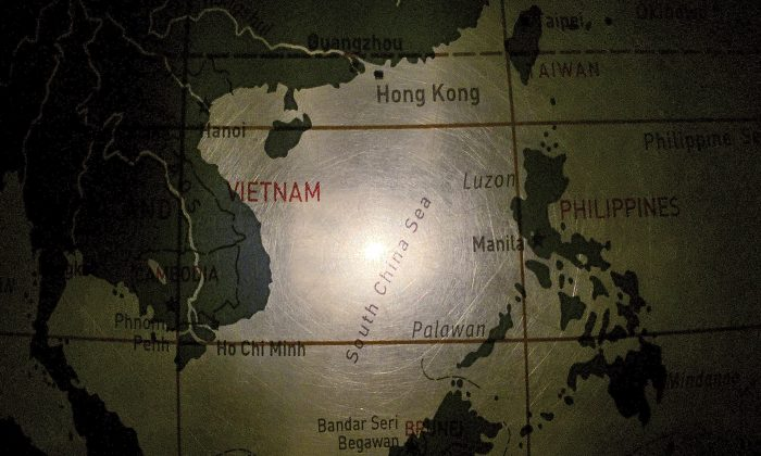 An illuminated globe shows the South China Sea at a museum in Pathumthani, Thailand. (AP Photo/Charles Dharapak)