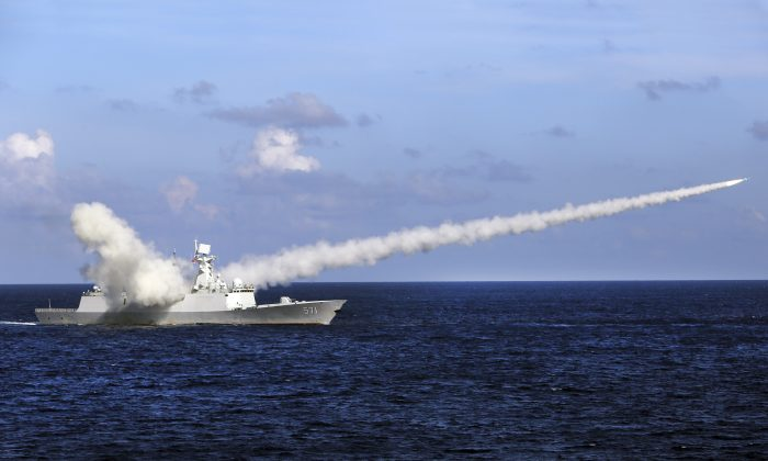 A Chinese missile frigate Yuncheng launches an anti-ship missile during a military exercise in the waters near south China's Hainan Island and Paracel Islands on July 8, 2016. (Zha Chunming/Xinhua via AP)