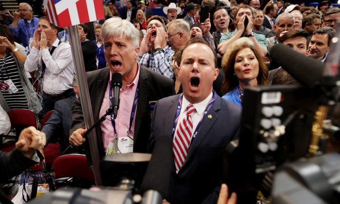 Sen. Mike Lee, (R-UT) (C) and Phill Wright, Vice Chair of the Utah State Delegation (L) shout no to the adoption of rules without a roll call vote on the first day of the Republican National Convention on July 18, 2016 at the Quicken Loans Arena in Cleveland, Ohio. An estimated 50,000 people are expected in Cleveland, including hundreds of protesters and members of the media. The four-day Republican National Convention kicks off on July 18.  (Chip Somodevilla/Getty Images)