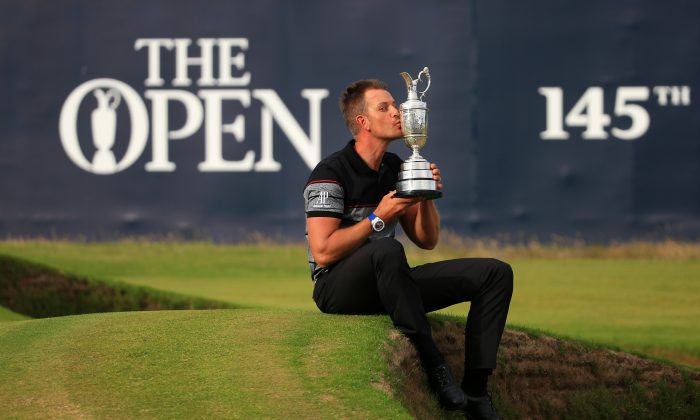 Henrik Stenson celebrates victory as he kisses the Claret Jug on the the 18th green after the final round on day four of the 145th Open Championship at Royal Troon on July 17 in Troon, Scotland. (Matthew Lewis/Getty Images)