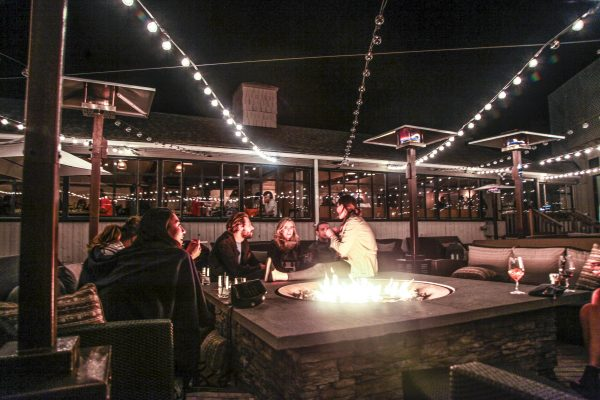 Enjoying food and drinks by the firepit. (Courtesy of Dan's Taste of Summer)