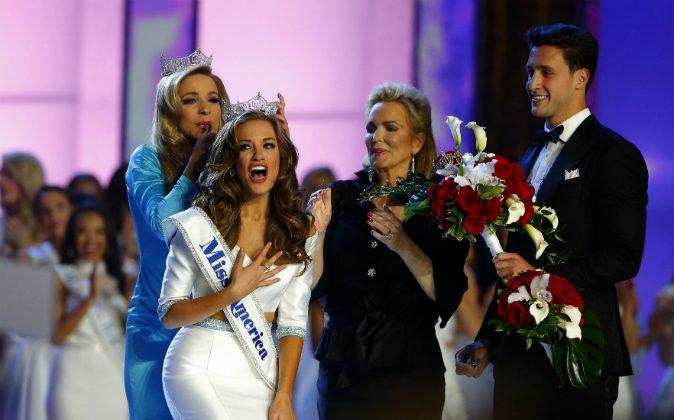 In this Sept. 13, 2015, file photo, Miss America 2015 Kira Kazantsev crowns Miss Georgia Betty Cantrell as Miss America 2016 in Atlantic City, N.J. (AP Photo/Noah K. Murray, File)