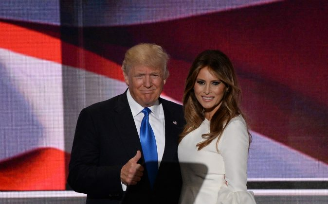 Presumptive Republican presidential candidate Donald Trump stands on stage with his wife Melania Trump on the first day of the Republican National Convention at Quicken Loans Arena in Cleveland, OH., on July 18, 2016. (ROBYN BECK/AFP/Getty Images)