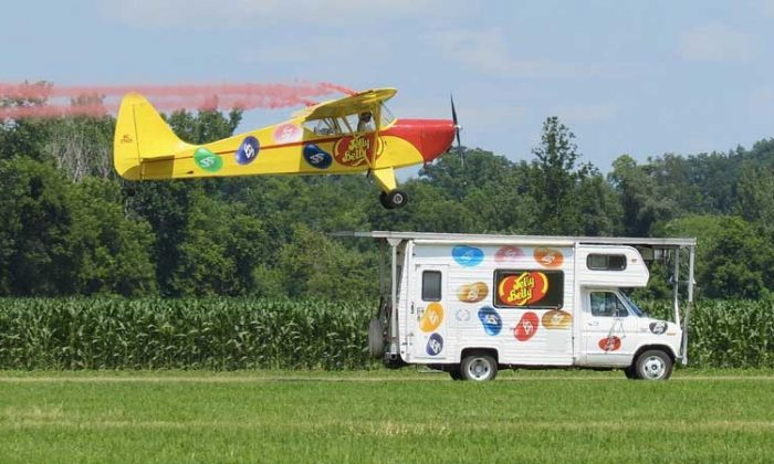Aerobatic performer Kent Pietsch lands on moving RV. (courtesy NY Air Show)