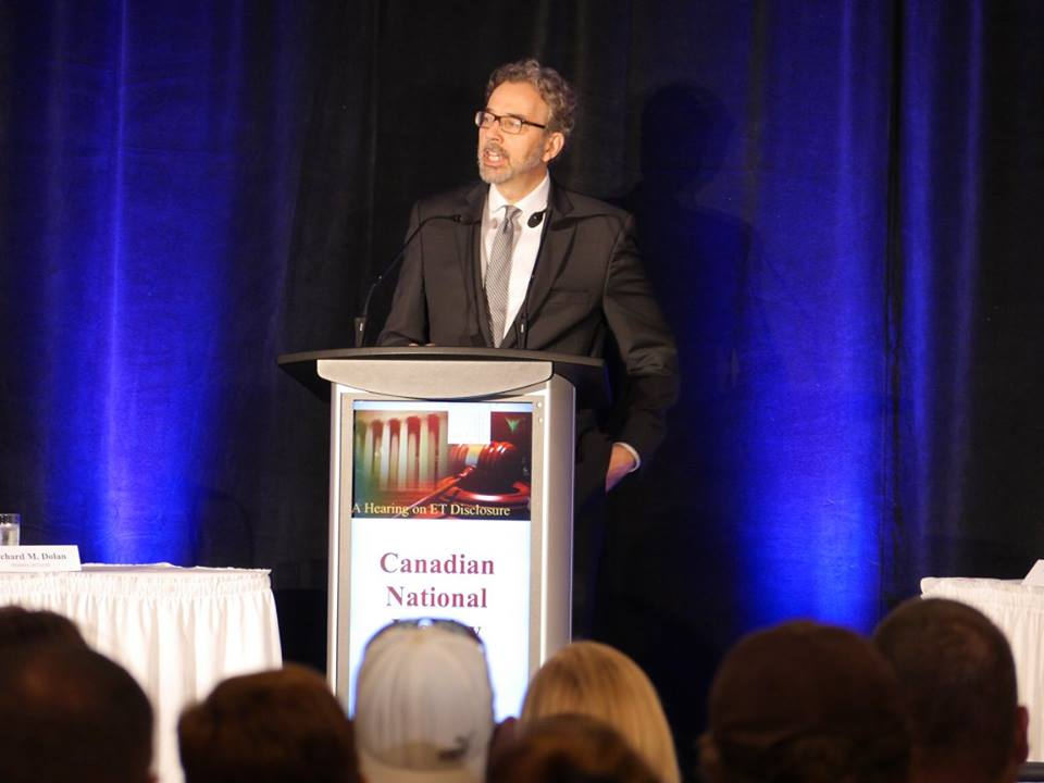 Richard Dolan, a researcher of unidentified aerial phenomena (UAP), speaks at a UAP disclosure hearing in Brantford, Canada, on June 25, 2016. (Courtesy of Zland Communications)