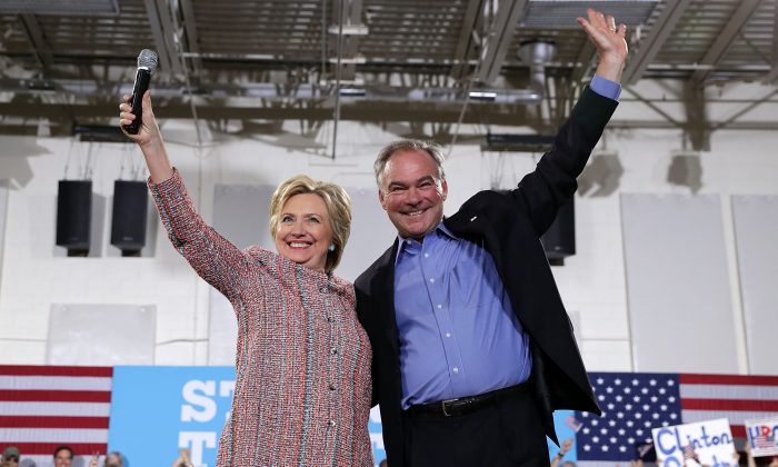 Democratic presidential candidate Hillary Clinton (L) and U.S. Sen. Tim Kaine (D-VA) during a campaign event at Ernst Community Cultural Center at Northern Virginia Community College July 14, 2016 in Annandale, Virginia. Hillary Clinton continued to campaign for the general election in November.  (Alex Wong/Getty Images)