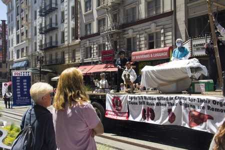 Actors hold an anti-persecution demonstration on a float in the parade in San Francisco on July 16. (Epoch Times)