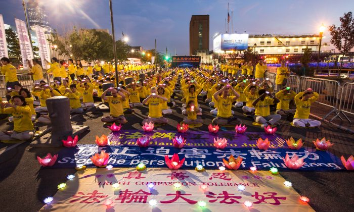 Hundreds of Falun Gong practitioners and supporters, hold a candlelight vigil in front of the Chinese Consulate in New York on July 20, 2016. (Benjamin Chasteen/Epoch Times)