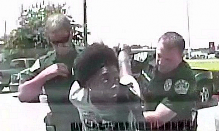 Two Texas police officers are under investigation after a video captured the moment one of them body slammed a black female school teacher to the ground in an arrest. (Austin Police Department)