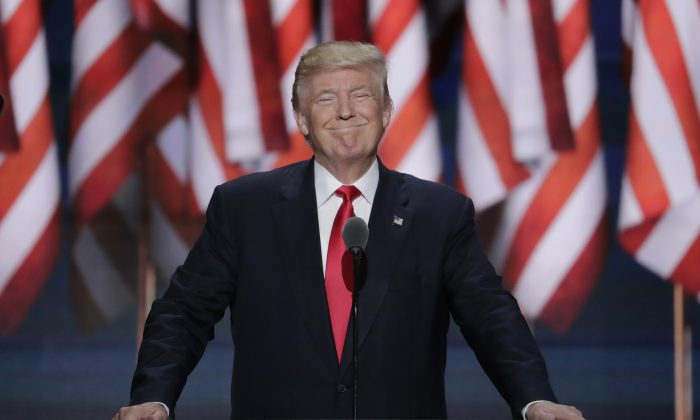 Republican Presidential Candidate Donald J. Trump, smiles as he takes the stage during the final day of the Republican National Convention in Cleveland, Thursday, July 21, 2016. (AP Photo/J. Scott Applewhite)