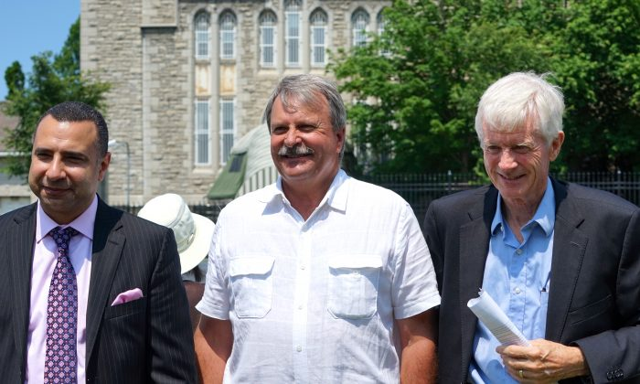 (L-R) Rev. Majed El Shafie of One Free World International, Ontario MPP Jack MacLaren, and former MP Hon. David Kilgour at a rally outside the Chinese embassy in Ottawa on July 20, 2016, to mark the 17th anniversary of the persecution against Falun Gong in China, launched by former Chinese Communist Party leader Jiang Zemin on July 20, 1999. The three men spoke at the event and condemned the Chinese regime's illegal persecution against the traditional spiritual practice as well as the state-led killing of Falun Gong prisoners of conscience for their organs in China. (Pam McLennan/Epoch Times)